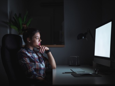 woman working late long hours featured