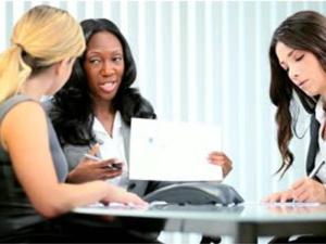diverse women in the boardroom